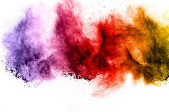 Explosion of color powder on white background. Abstract multicolored powder splatted on white background,Freeze motion of color powder explosion Royalty Free Stock Photography