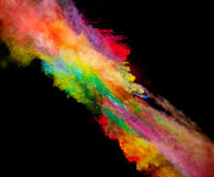 Explosion of colored powder on black background Royalty Free Stock Image