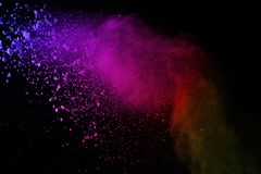 Explosion of colored powder on black background. Colorful of dust explode. royalty free stock photos