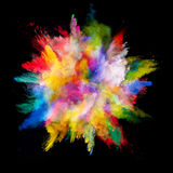 Explosion of colored powder on black background Royalty Free Stock Photography
