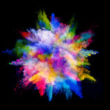 Explosion of colored powder on black background Stock Photography