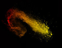 Explosion of colored powder on black background. Explosion of colored powder, isolated on black background stock image