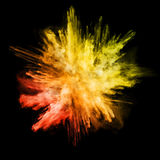 Explosion of colored powder on black background Royalty Free Stock Photos