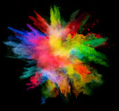 Explosion of colored powder on black background. Explosion of colored powder, isolated on black background. Power and art concept, abstract blust of colors royalty free stock photography