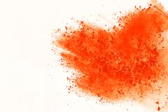 Colored powder explosion. Colore dust splatted. Explosion of colored powder isolated on white background. Power or clouds splatted. Freez motion of orange dust royalty free stock photo