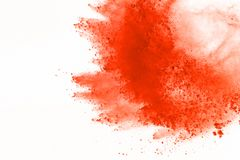 Colored powder explosion. Colore dust splatted. Explosion of colored powder isolated on white background. Power or clouds splatted. Freez motion of orange dust royalty free stock photography