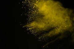 Colored powder explosion. Colore dust splatted. Explosion of colored powder isolated on white background. Power or clouds splatted. Freez motion of yellow dust royalty free stock photo