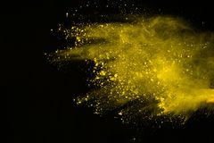Colored powder explosion. Colore dust splatted. Explosion of colored powder isolated on white background. Power or clouds splatted. Freez motion of yellow dust stock images