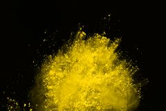 Colored powder explosion. Colore dust splatted. Explosion of colored powder isolated on white background. Power or clouds splatted. Freez motion of yellow dust royalty free stock images