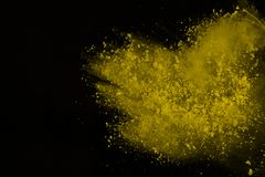 Colored powder explosion. Colore dust splatted. Explosion of colored powder isolated on white background. Power or clouds splatted. Freez motion of yellow dust stock photos