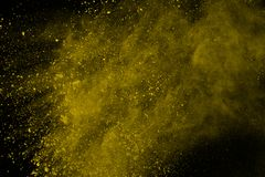 Colored powder explosion. Colore dust splatted. Explosion of colored powder isolated on white background. Power or clouds splatted. Freez motion of yellow dust stock image
