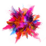 Explosion of colored powder on white background Stock Images