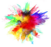 Explosion of colored powder on white background. Explosion of colored powder, isolated on white background. Power and art concept, abstract blust of colors Stock Photo