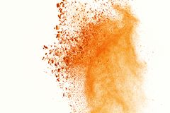 Explosion of colored powder on white background. Orange colored stock photography