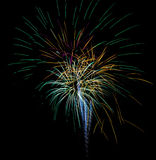 Explosion of Colors. Fireworks explosions light the night with beautiful colors including, blue, green, aqua, purple, orange and yellow during a 4th of July stock images