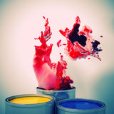 Explosion of colour. 3d image of color metal tank and splash Stock Images