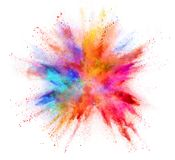 Explosion of coloured powder isolated on white background Stock Photo