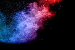 Explosion de poudre de couleur sur le fond noir image libre de droits