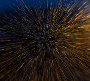 Explosion effect. Zoomed raindrops on illuminated window  creates an explosion effect Royalty Free Stock Images