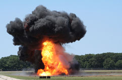 Explosion in Field. A simulated attack eplosion near an airfield Stock Photo