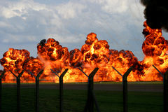 Explosion. Fire at raf fariford heat dramatic war petrol napalm cloud orange red fence Royalty Free Stock Photo