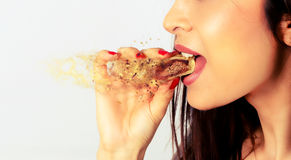 Explosion of flavor . Closeup of a woman eating a delicious cake Royalty Free Stock Photography