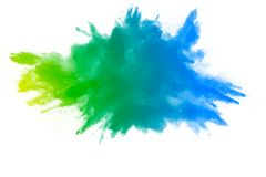 Explosion of green blue color powder on white background. Color dust splash stock image