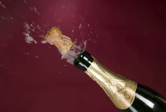 Explosion of green champagne bottle cork Royalty Free Stock Photography