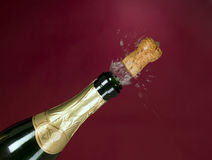 Explosion of green champagne bottle cork Royalty Free Stock Photos