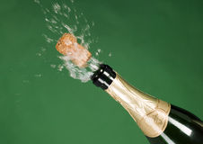 Explosion of green champagne bottle cork Royalty Free Stock Image