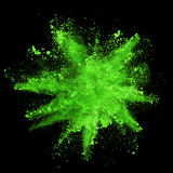 Explosion of green powder on black background. Explosion of green powder, isolated on black background Stock Images