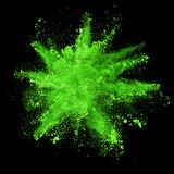 Explosion of green powder on black background Stock Images