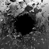 Explosion hole in concrete cracked wall. Industrial background