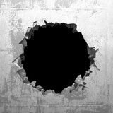 Explosion hole in concrete cracked wall. Industrial background Royalty Free Stock Image