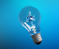 Explosion of ideas. Light bulb lamps on a colour Royalty Free Stock Photo