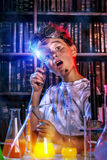 Explosion in a laboratory. A boy doing experiments in the laboratory. Explosion in the laboratory. Science and education Royalty Free Stock Photography