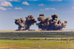 Explosion at a military training ground. Destruction of training objectives by aircraft bombs Stock Photography