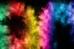 The explosion of multi colored powder. Beautiful rainbow color powder fly away. Royalty Free Stock Photos