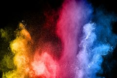 The explosion of multi colored powder. Beautiful rainbow color powder fly away. Stock Images