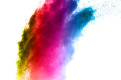 Multi colored powder explosion on white background. The explosion of multi colored powder. Beautiful rainbow color powder fly away. The cloud of glowing color royalty free stock image