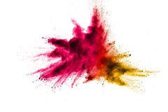 Explosion of multi colored powder. On white background Royalty Free Stock Images