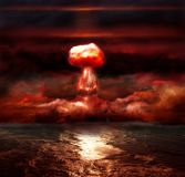 Explosion of nuclear bomb. Over sea Royalty Free Stock Image