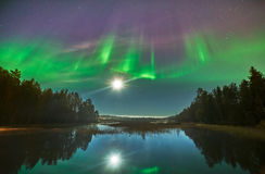 Explosion over Northern Lights in Sweden Royalty Free Stock Image