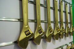 Explosion-preventing wrenches on wall. Golden wrenches,made from beryllium bronze,are used in explosive atmosphere for its attribute of no striking sparks Stock Photos