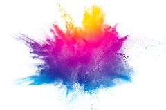 Explosion of rainbow color powder on white background.