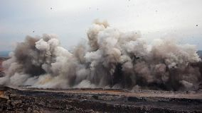 Explosion of rock in coal mining quarry
