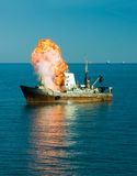 Explosion Of The Ship. Big explosion of the ship at the sea Royalty Free Stock Image