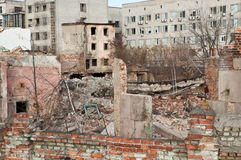 Explosion site. Destroyed houses in a bomb explosion Royalty Free Stock Photos