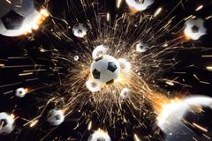 Soccer balls with fire sparks in action black isolate. Explosion soccer balls with fire sparks in action black isolate stock photos