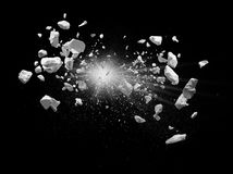Explosion. Split debris caused by explosion against black background stock photo